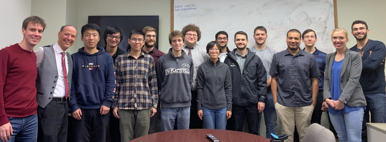 "UW–Platteville students visited CRSS in November 2019. UW–Platteville alumni include (sixth from left) Alec ""Max"" Steele, Aric Fowler, Jonas Wagner, Avamarie Brueggeman, Hazem Younis, Lucas Goncalves, and (second from right) Emma Mutschelknaus. Not pictured: Chelzy Belitz."